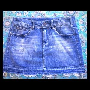 Denim skirt with skull embroidery on pockets
